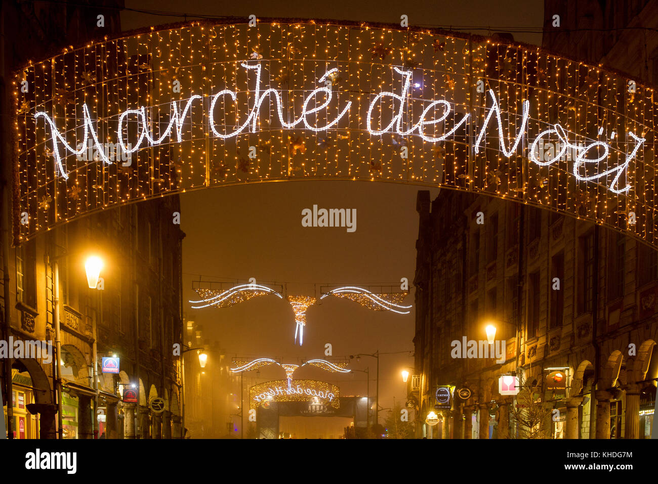 Illuminated sign advertising an outdoor Christmas market in Arras, France Stock Photo