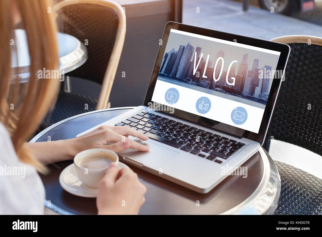 video blog, woman reading vlog online on computer - Stock Image