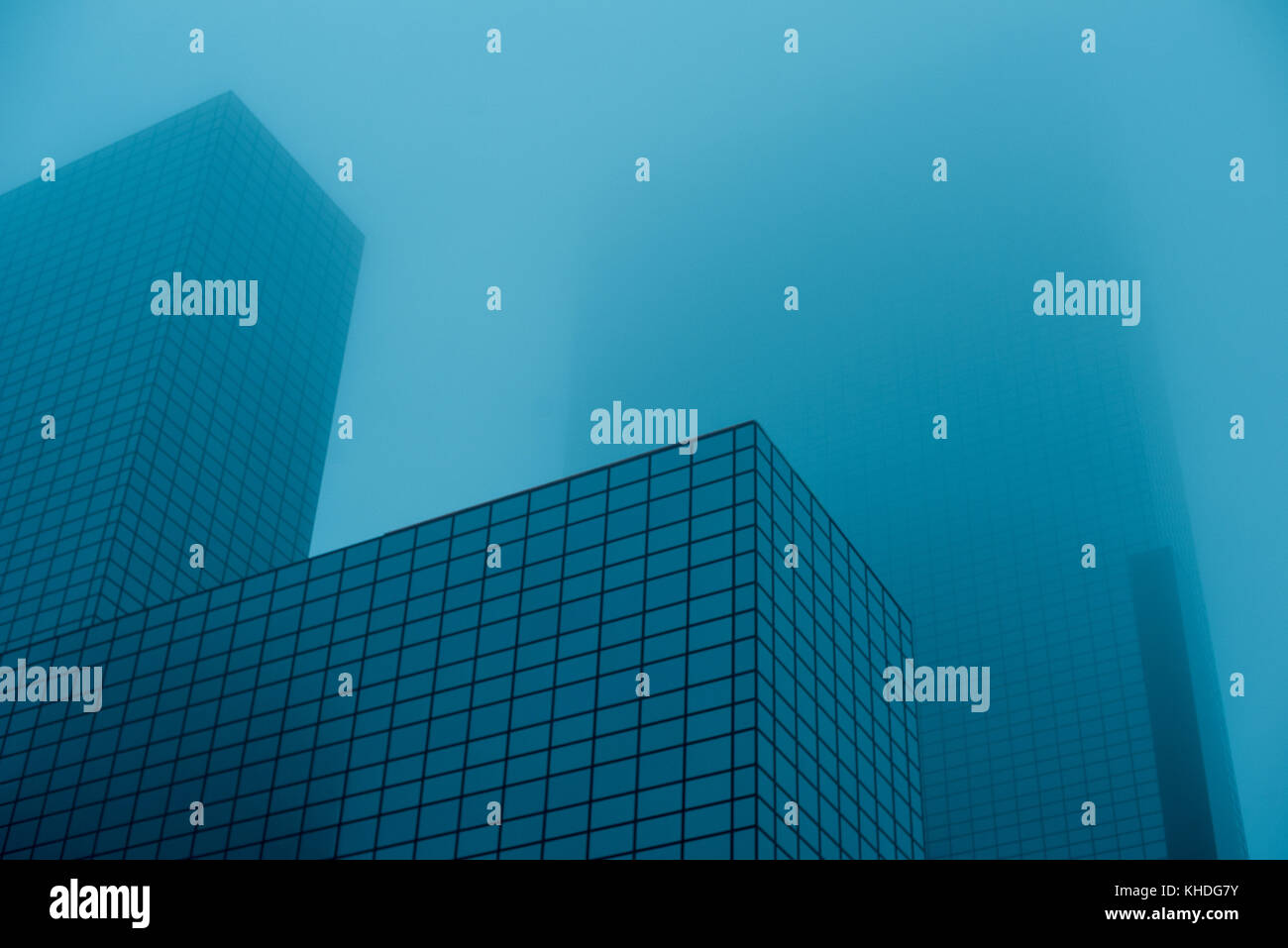 Tall skyscrapers disappearing into fog Stock Photo