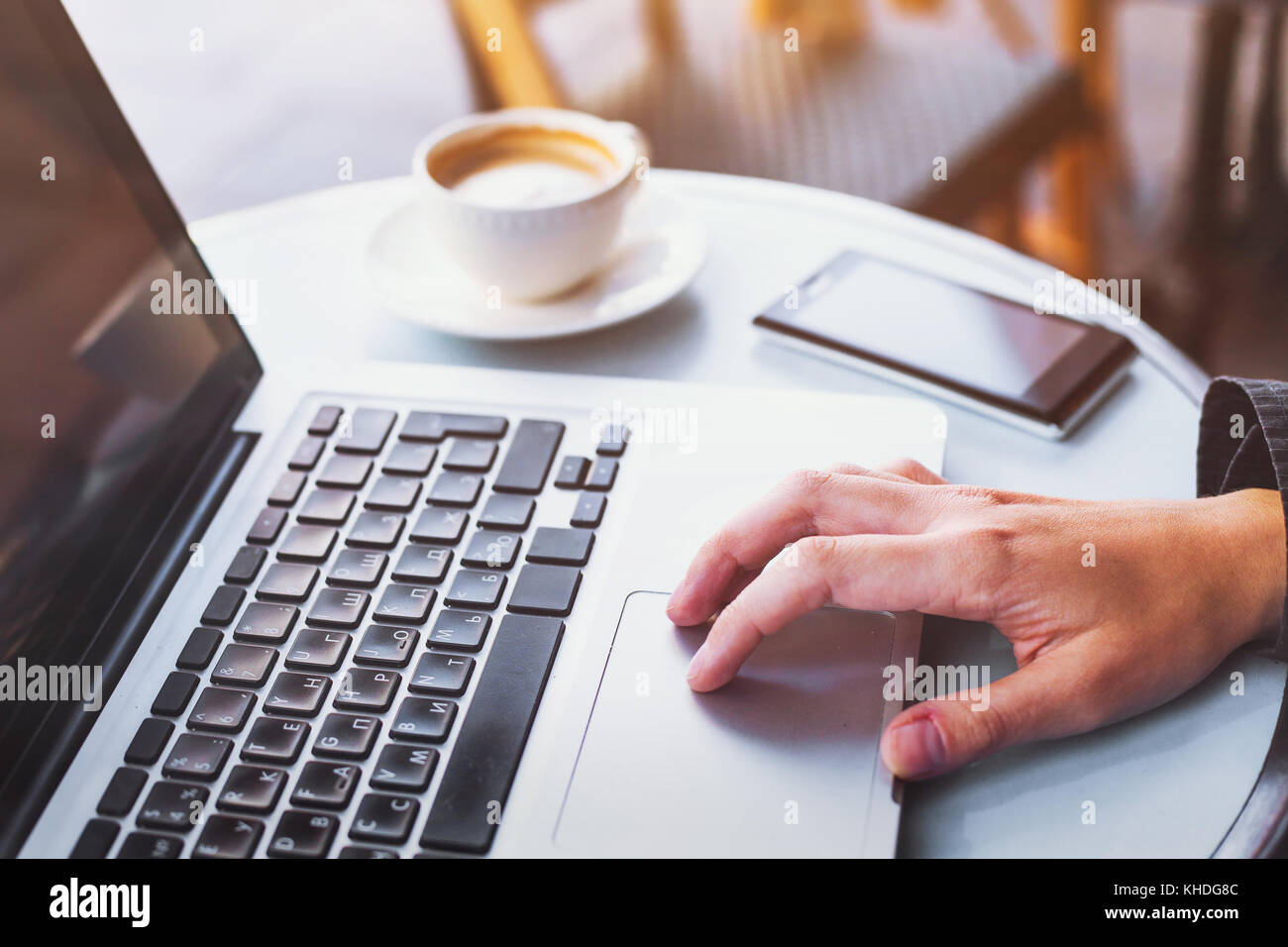 using internet on computer, closeup of hand - Stock Image