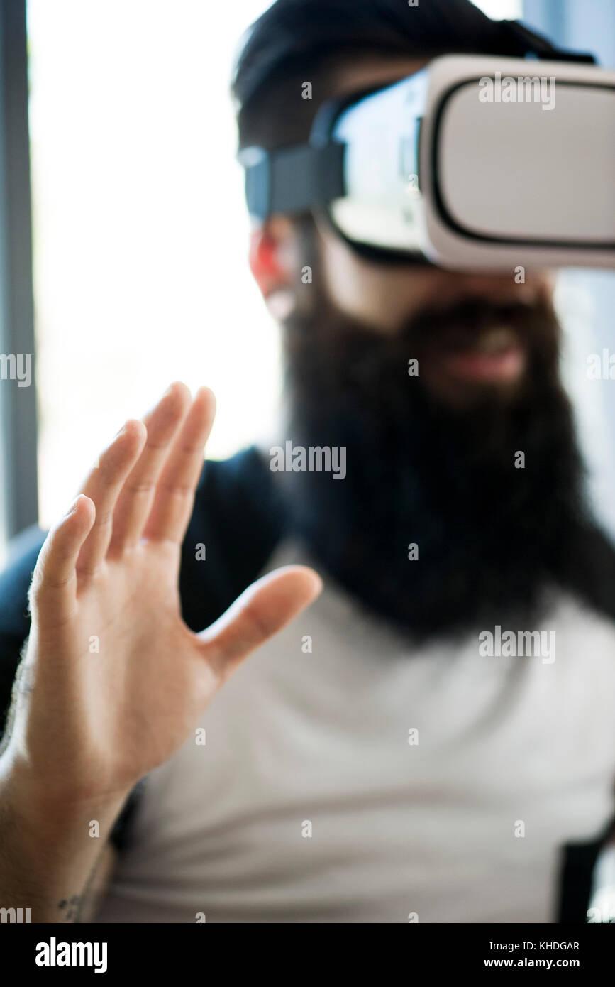 Man using virtual reality simulator Stock Photo