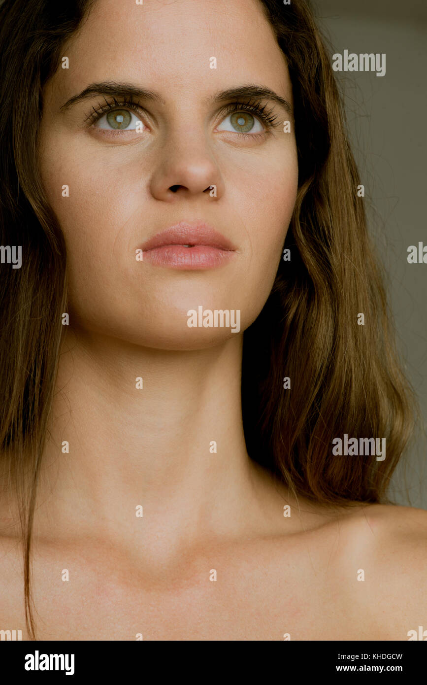 Young woman looking up in thought, portrait Stock Photo
