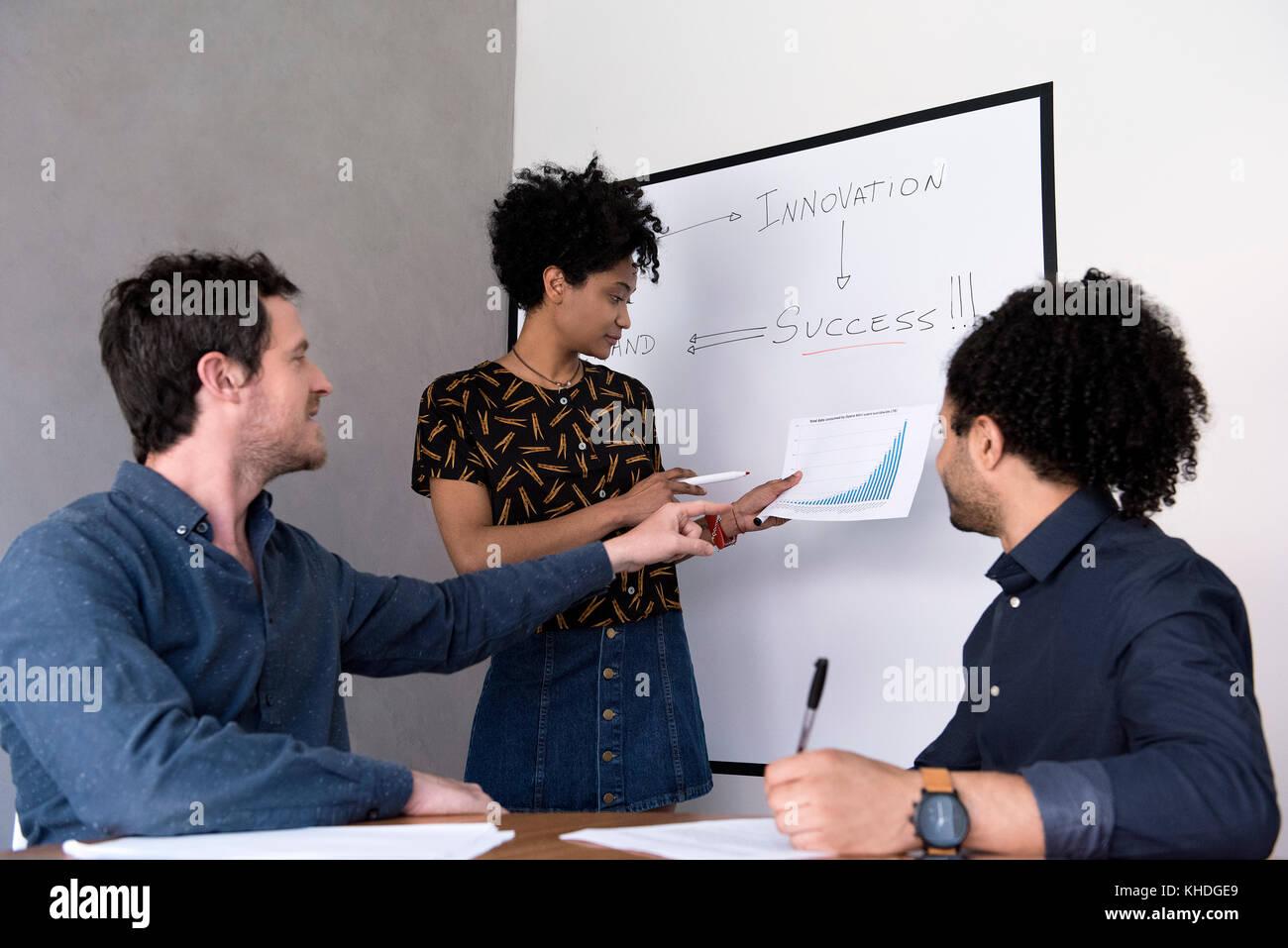 Student asking teacher question Stock Photo