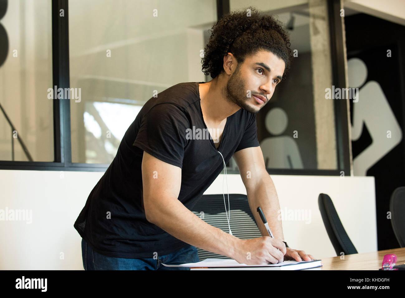 Young man writing Stock Photo