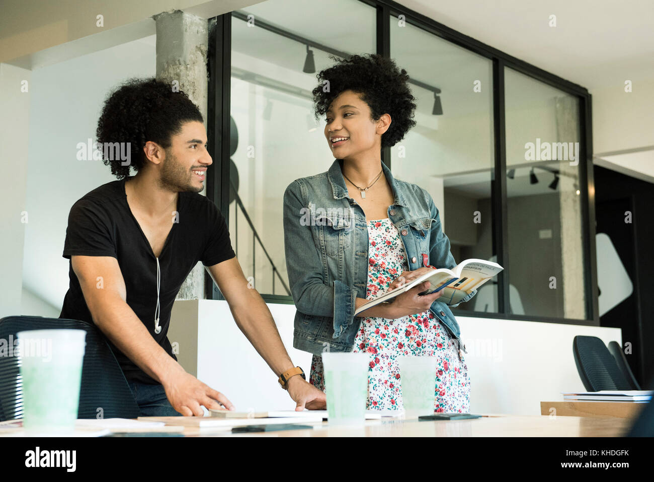 Colleagues working together in office Stock Photo
