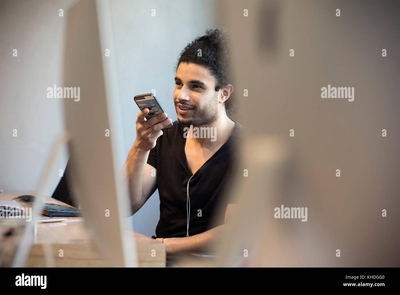 Young man talking on smart phone Stock Photo