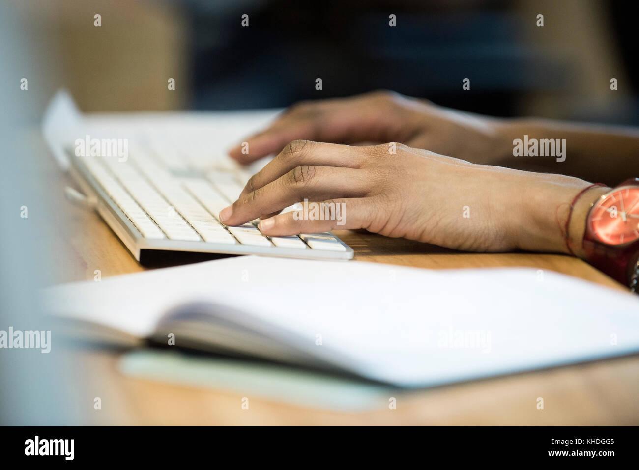 Woman typing on keyboard Stock Photo