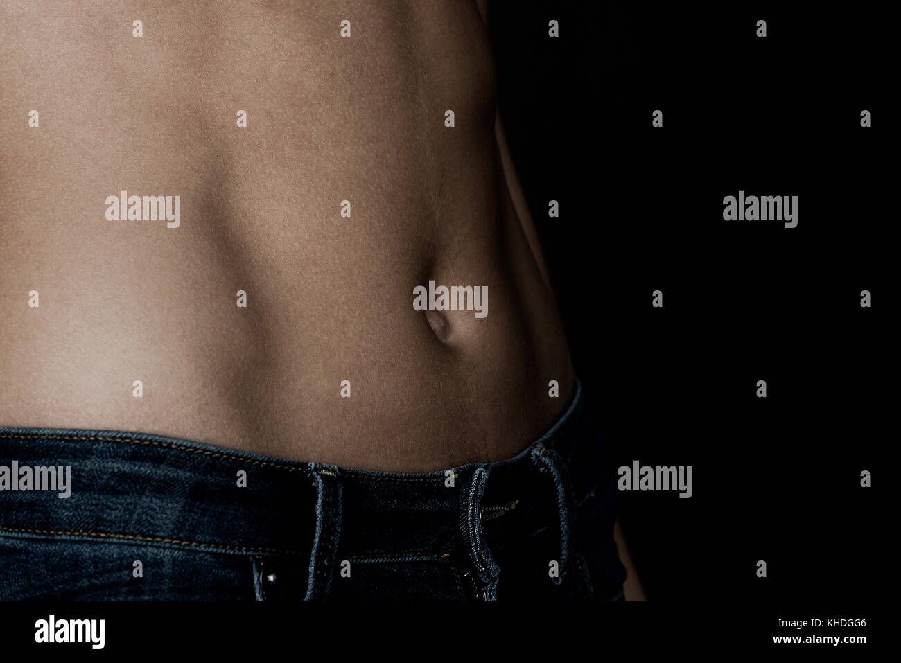 Close-up of woman's bare stomach Stock Photo