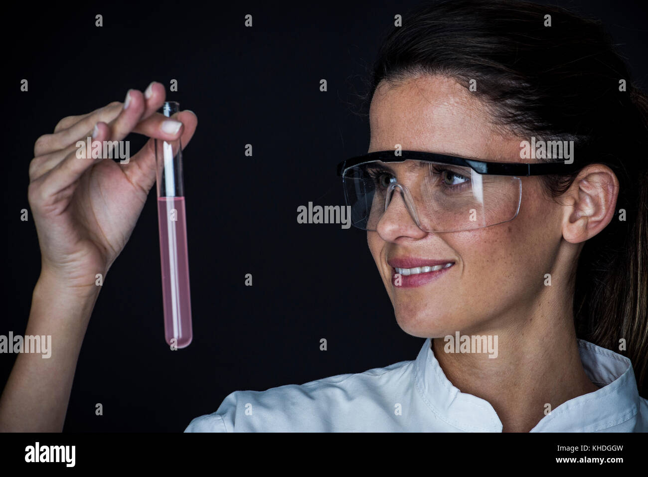 Young woman looking at liquid in test tube Stock Photo