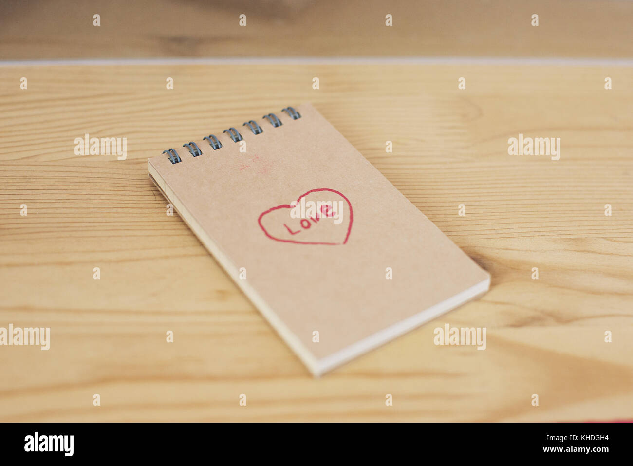 Note pad with heart shape and word love written on cover Stock Photo