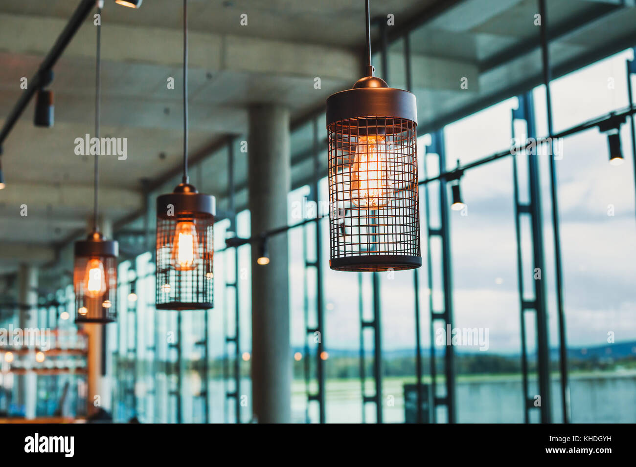 hanging lamps in abstract modern interior of cafe or restaurant, scandinavian design Stock Photo
