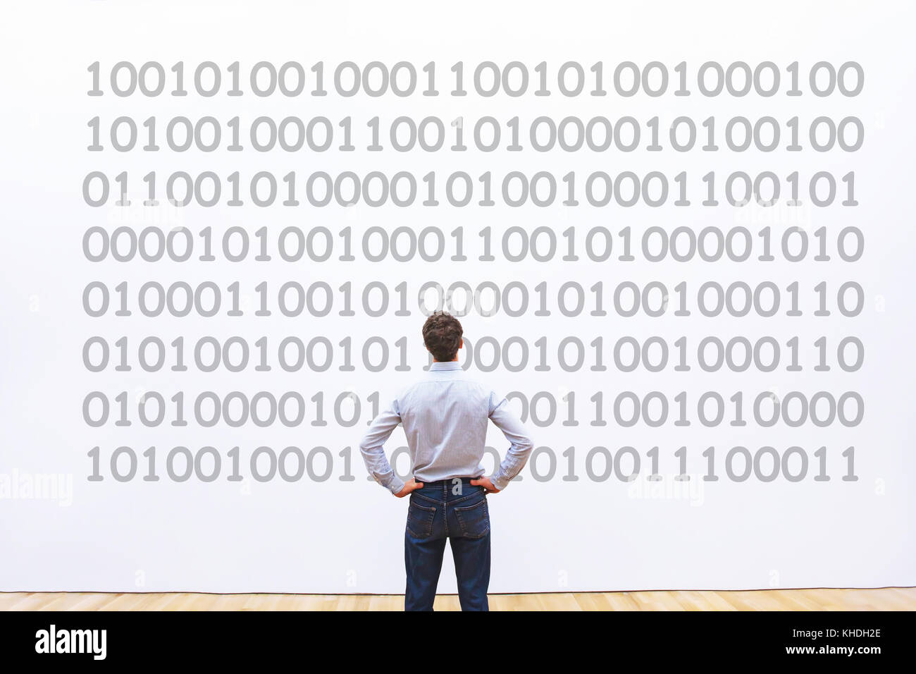 man programmer looking at binary code, coding concept, data encryption - Stock Image