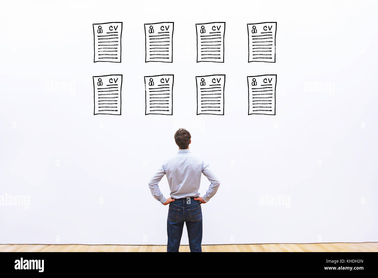 human resource manager looking at many different cv resume and choosing perfect person to hire - Stock Image