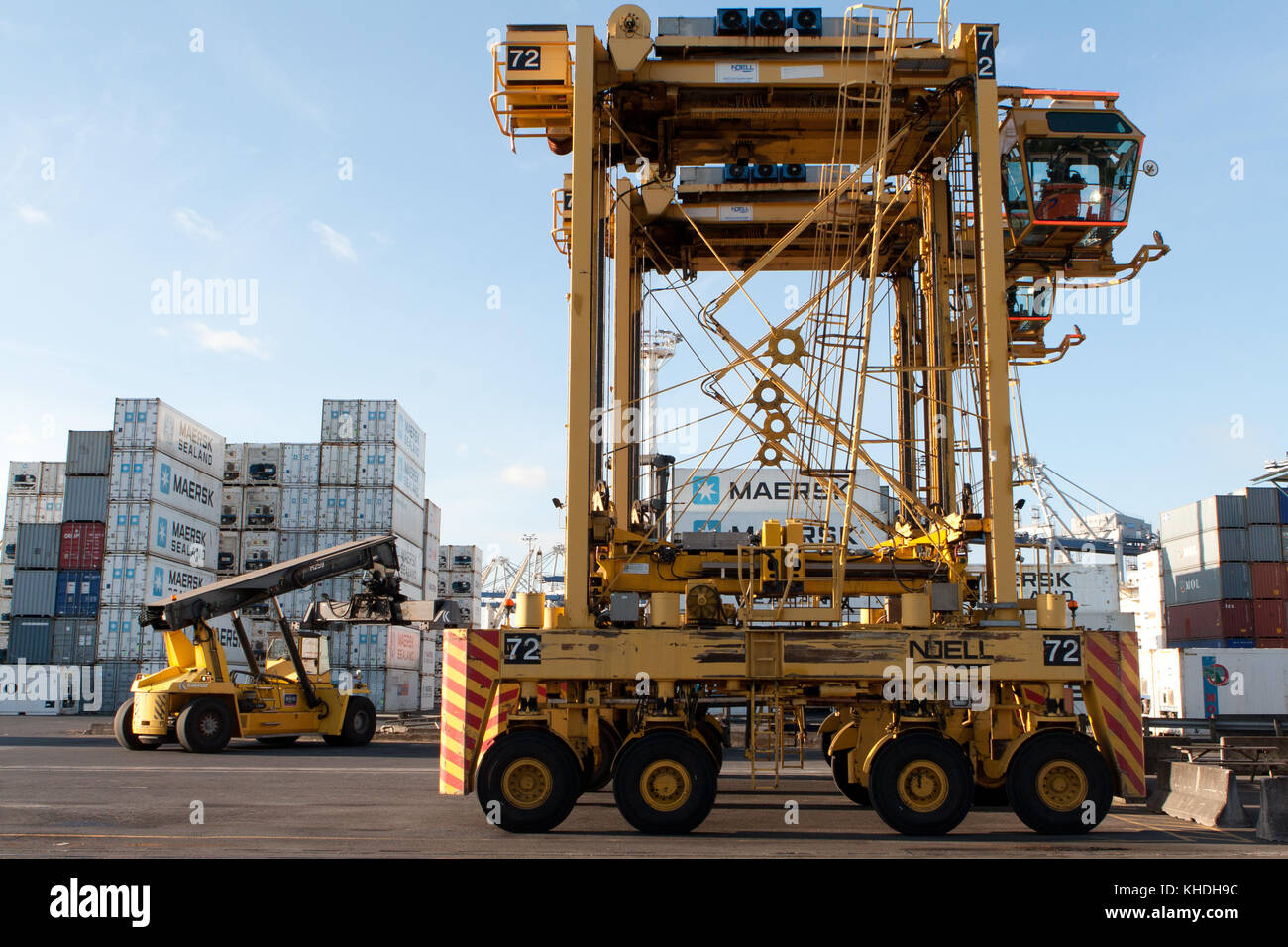 AUCKLAND, NEW ZEALAND - 17th APRIL 2012: Noell straddle carriers and stack of containers at Auckland port. - Stock Image