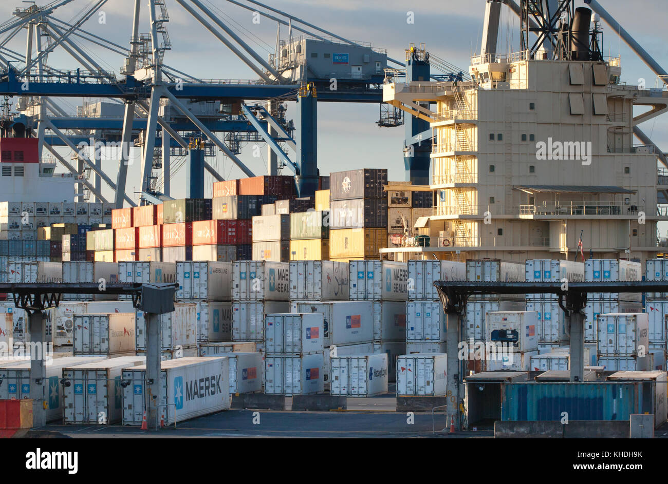 AUCKLAND, NEW ZEALAND - 17th APRIL 2012: Wheeled cranes and stack of containers at port of Auckland. - Stock Image