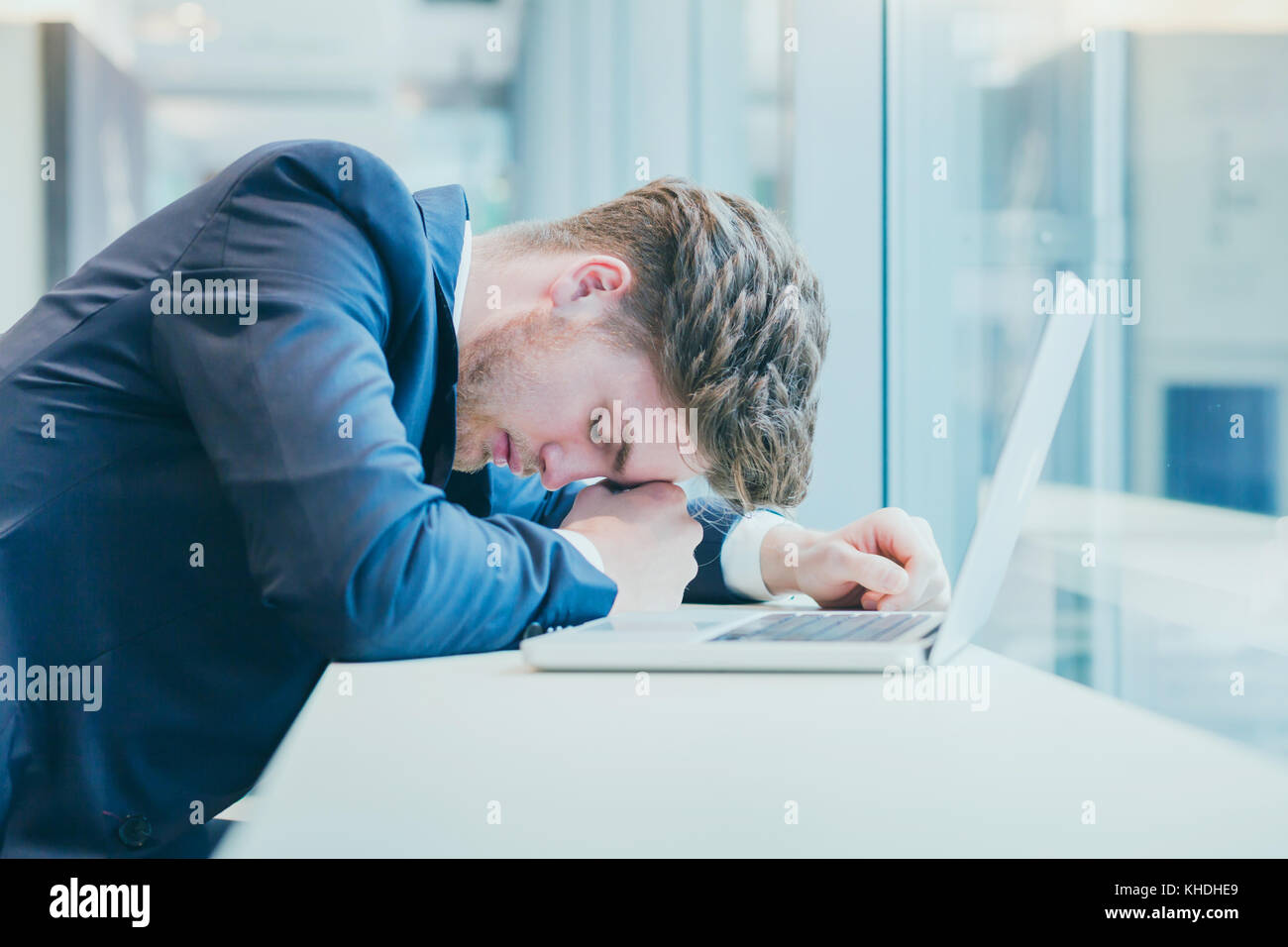 failure concept or bad news, desperate sad tired business man with many hopeless problems, stress at work - Stock Image
