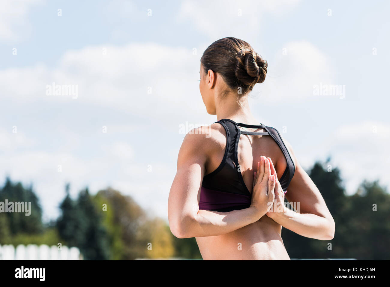 yogini in Reverse Prayer Pose - Stock Image