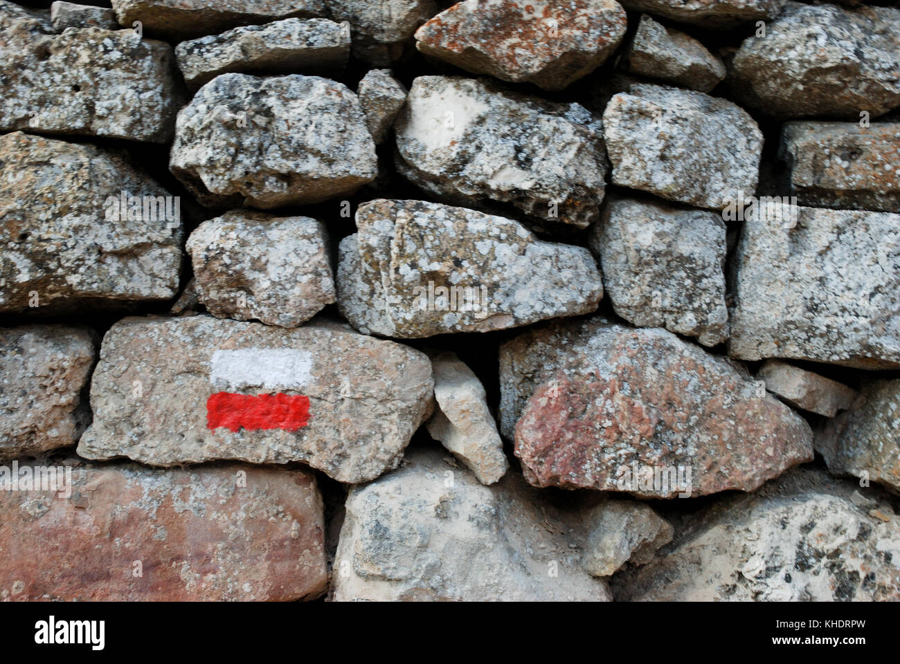 GR path mark painted on stone wall. - Stock Image
