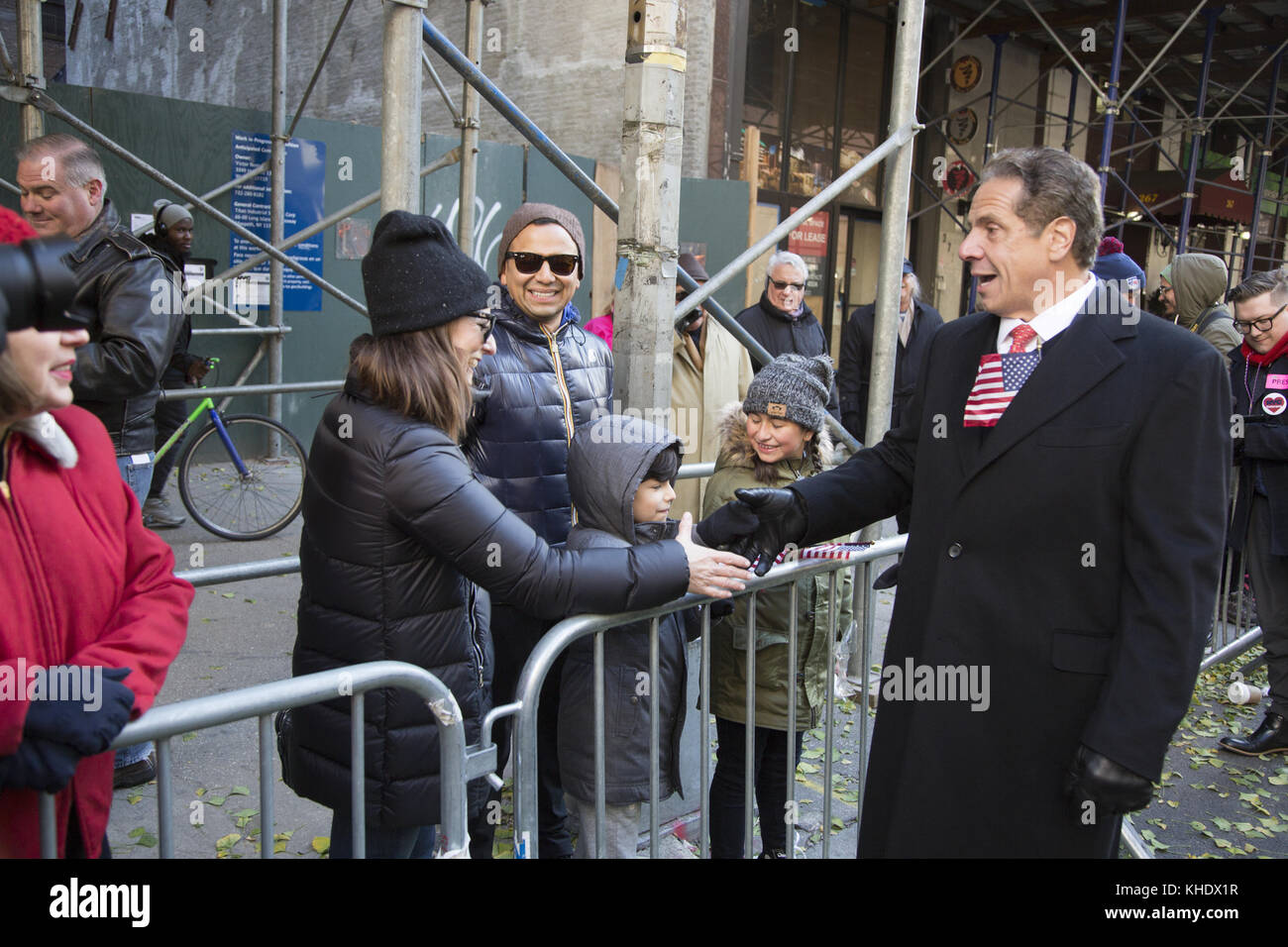 New York State Governer Andrew Cuomo greets spectators as he marches up 5th Avenue in the Verterans Day Parade in - Stock Image