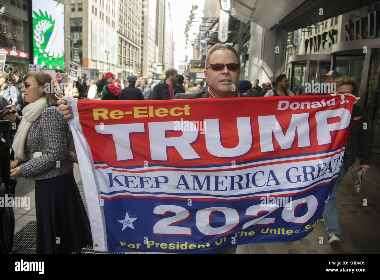 Trump supporter outside a large anti Trump/Pence regime rally in Times Square in New York City. - Stock Image