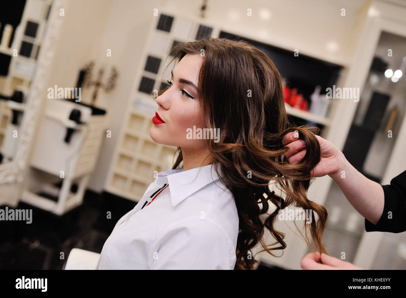 Young beautiful girl in a hairdresser or beauty salon - Stock Image
