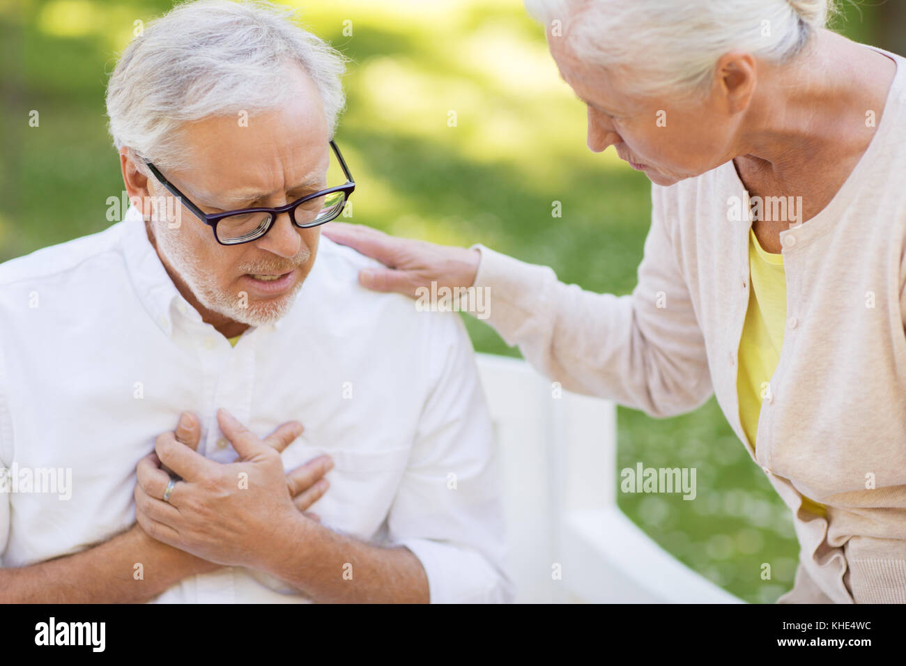 close up of senior man with heartache at park - Stock Image