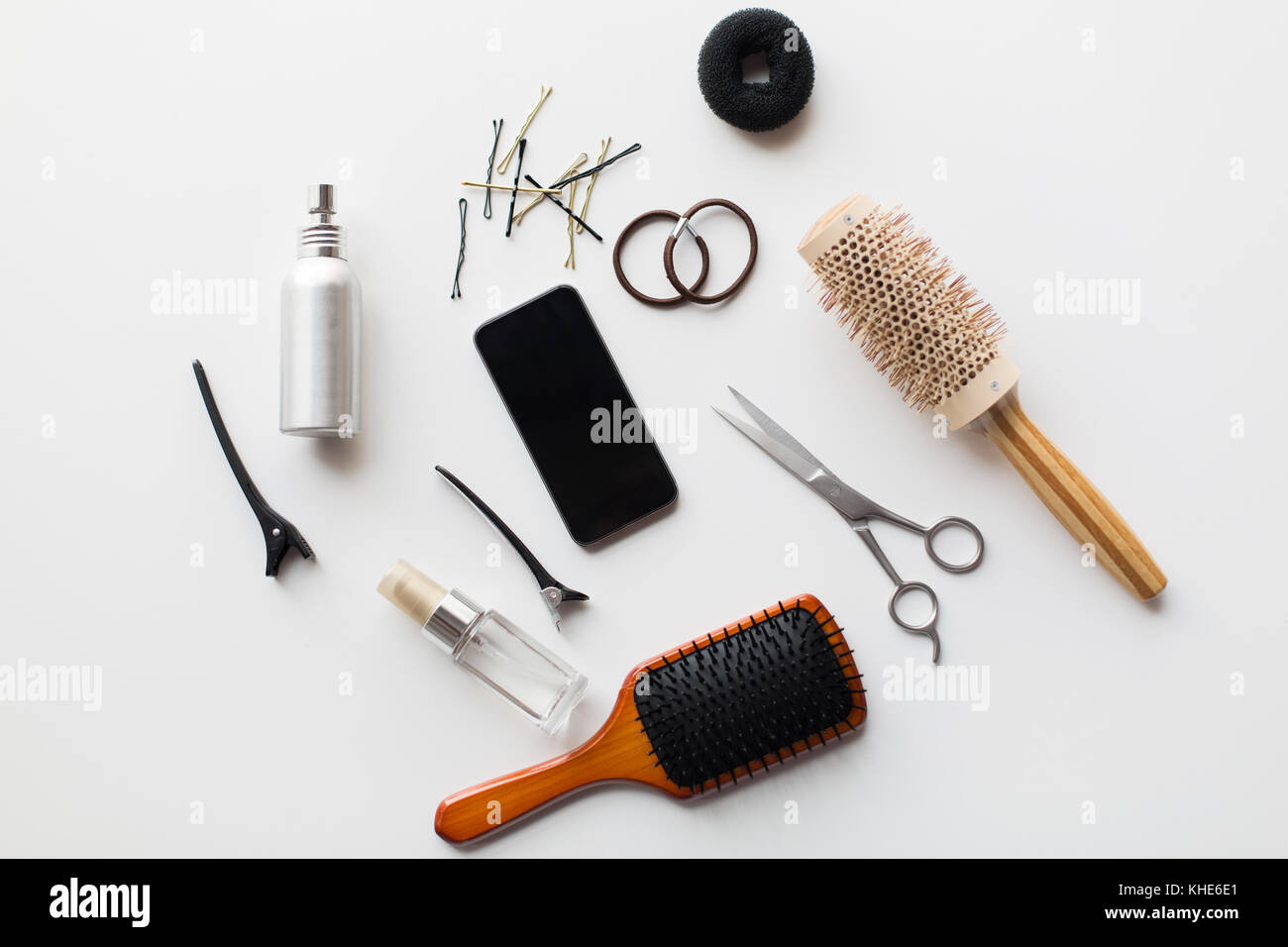 smartphone, scissors, brushes and other hair tools Stock Photo