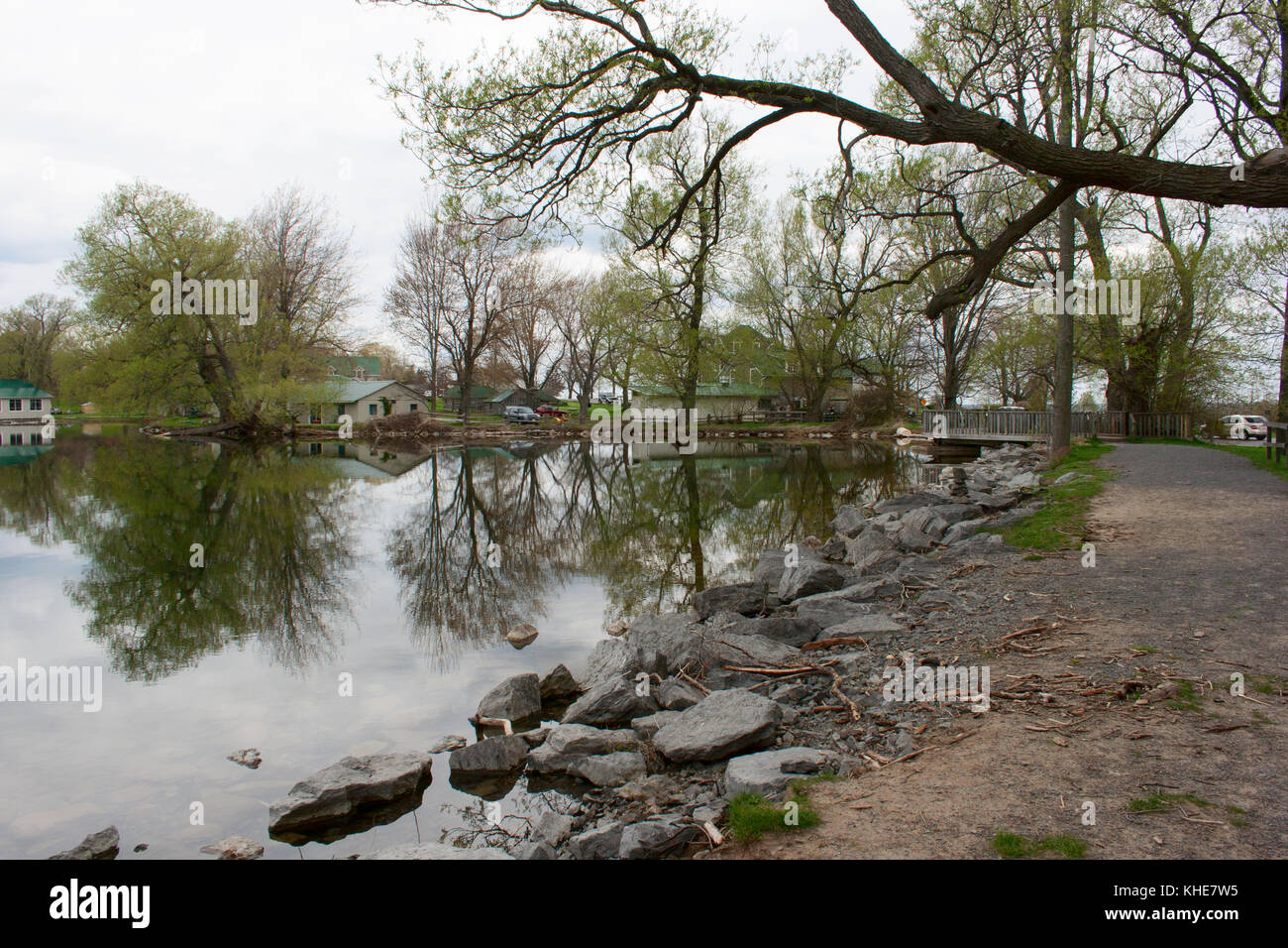 Quiet lake and houses in Prince Edward County - Stock Image
