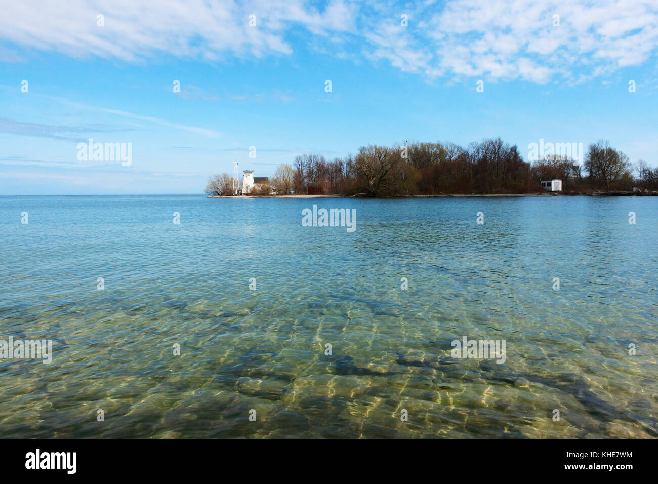 Lake and lighthouse in Prince Edward County, Ontario - Stock Image