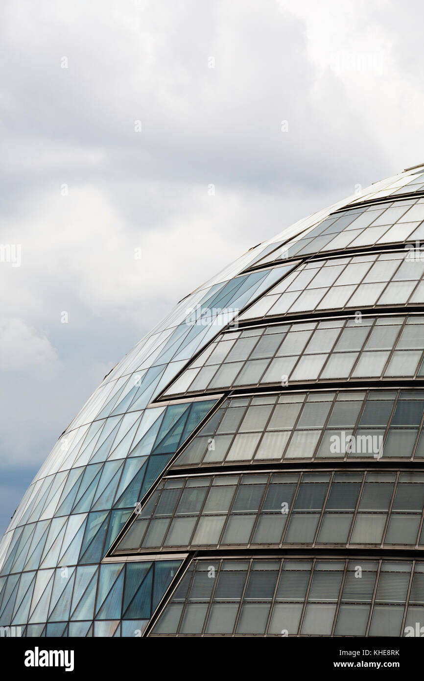 London, UK. Detail view of the windows of City Hall on the south bank of the River Thames. - Stock Image