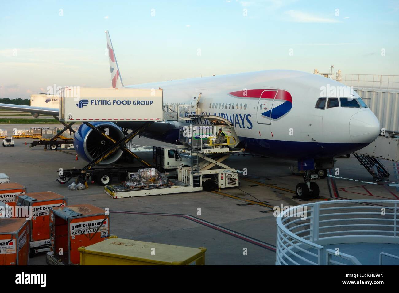 A British Airways jet being serviced by Flying Food Group scissor lifts at Orlando International Airport, Florida, - Stock Image
