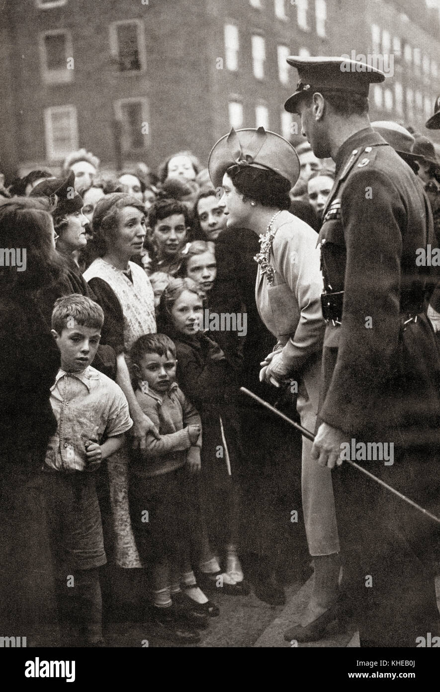 Queen Elizabeth visiting the people of London during World War Two.  Queen Elizabeth, The Queen Mother.  Elizabeth - Stock Image