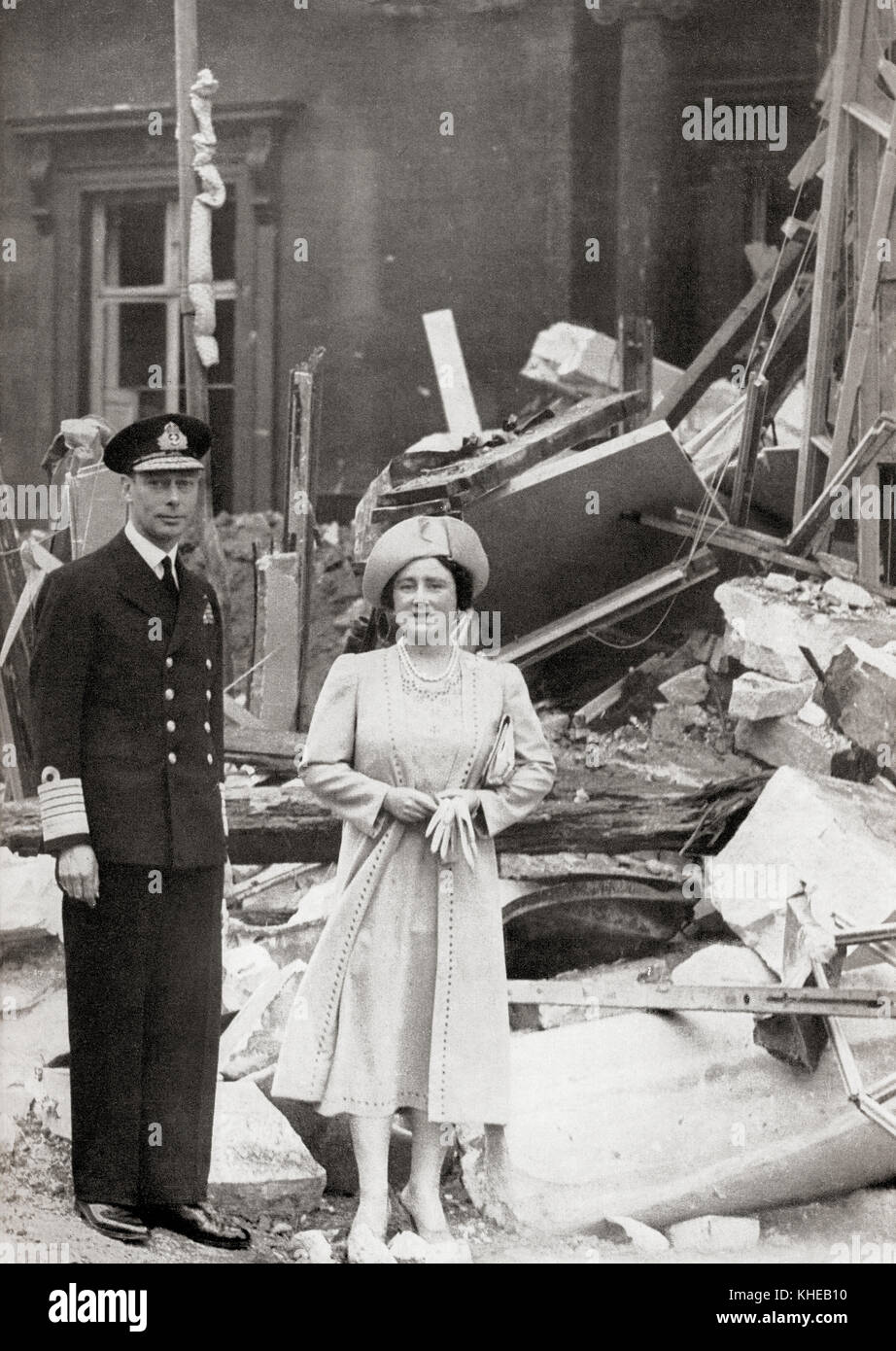 King George VI and Queen Elizabeth outside Buckingham Palace which suffered bomb damage on 13 September 1940, during - Stock Image