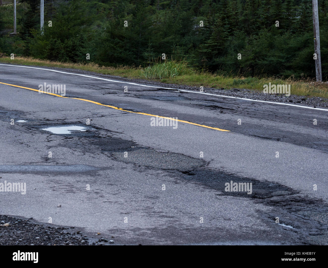 Potholes in the roadway, Highway 430, the Viking Trail, Newfoundland, Canada. - Stock Image