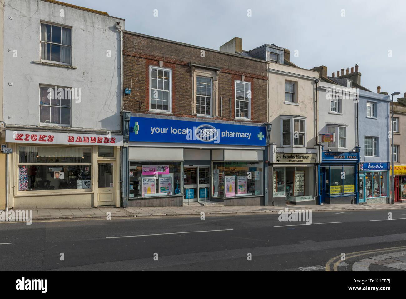 Run down shopping street, St Leonards, Hastings, East Sussex, England, UK - Stock Image