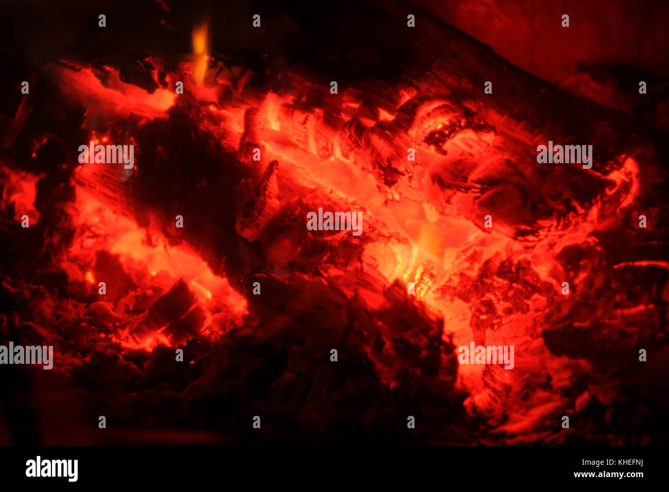 Fire burns in the fireplace - Stock Image