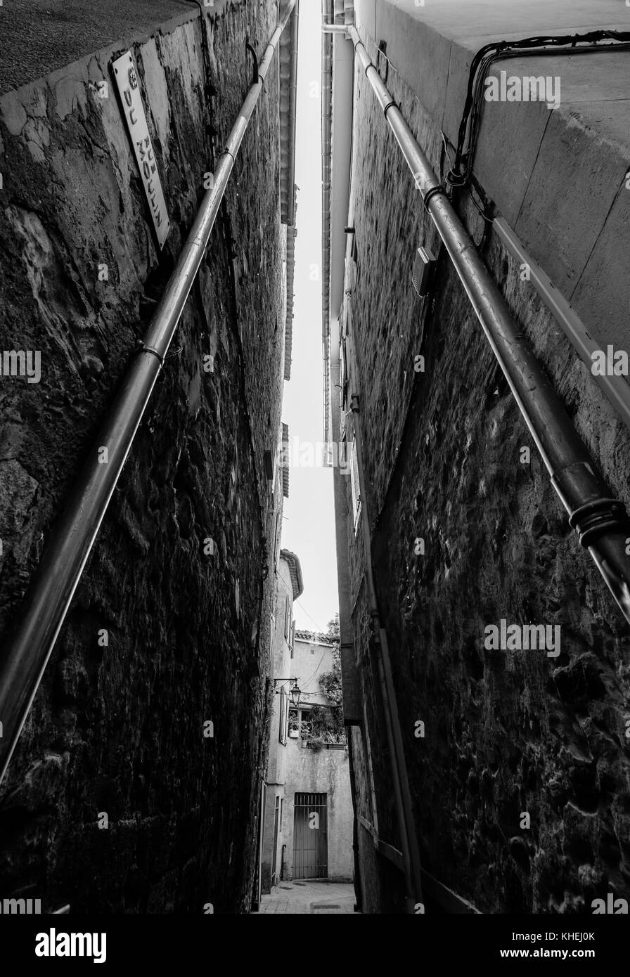 Narrow street in old city centre - Stock Image