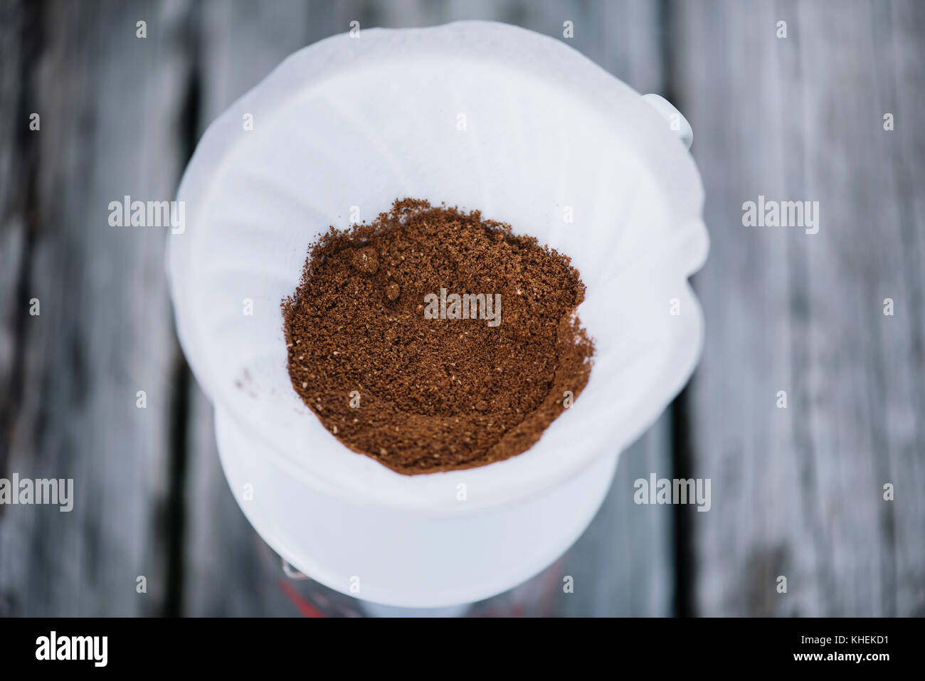 Freshly ground coffee beans in the pour over dripper, about to be brewed into delicious coffee - Stock Image