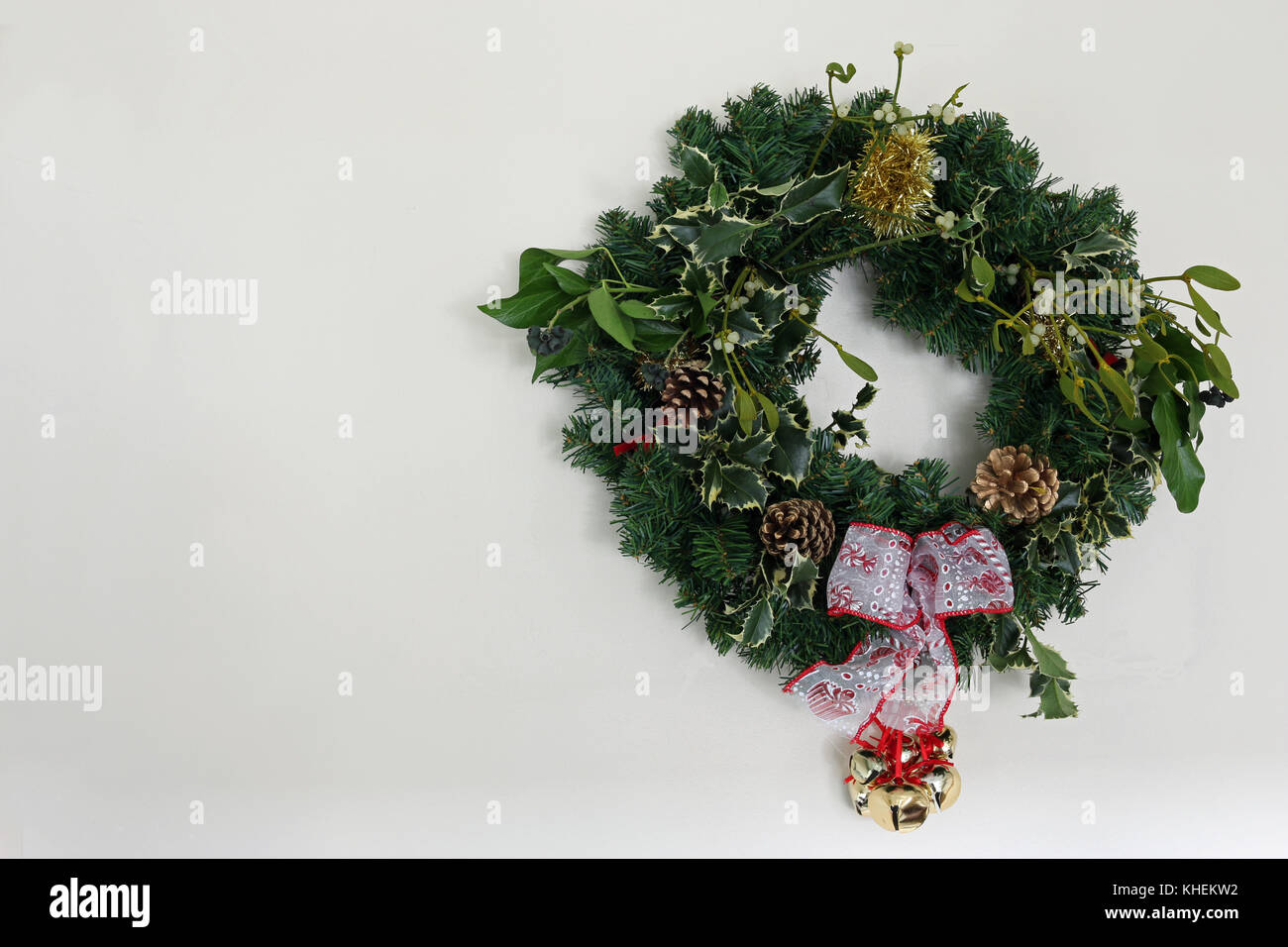 Home Made Christmas Wreath With Holly Mistletoe Pine Cones Ivy Tinsel