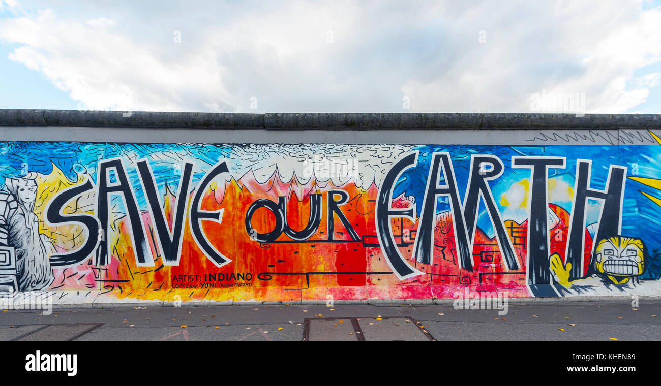 Lettering save our earth artist yvonne matzat painting of the berlin wall east side gallery berlin germany