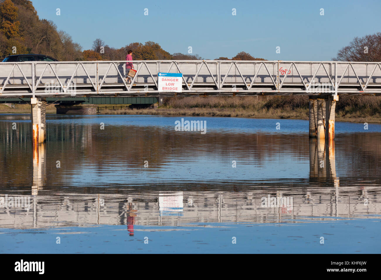 Rye, East Sussex, UK. 17th November, 2017. UK Weather. A female walking over a bridge of the River Rother. Photo - Stock Image