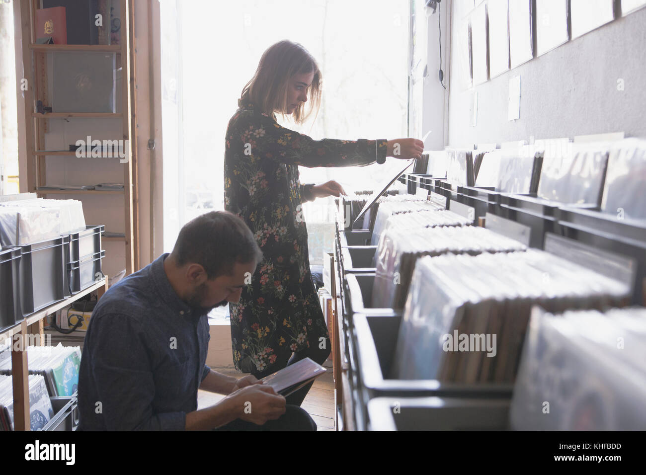 Young couple shopping for records together - Stock Image