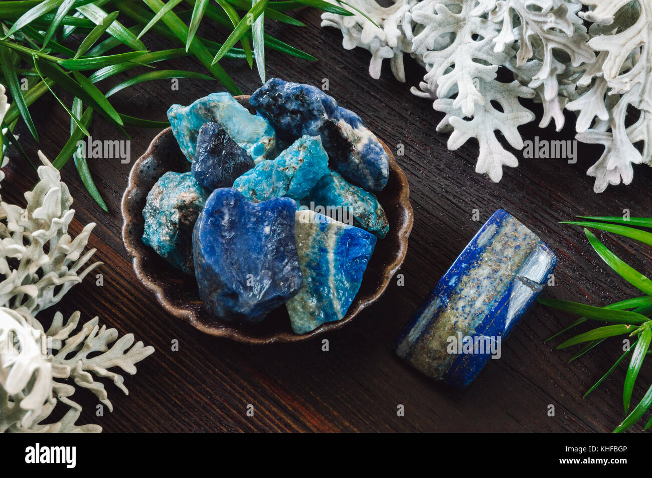 Stones of the Throat Chakra on Dark Table - Stock Image