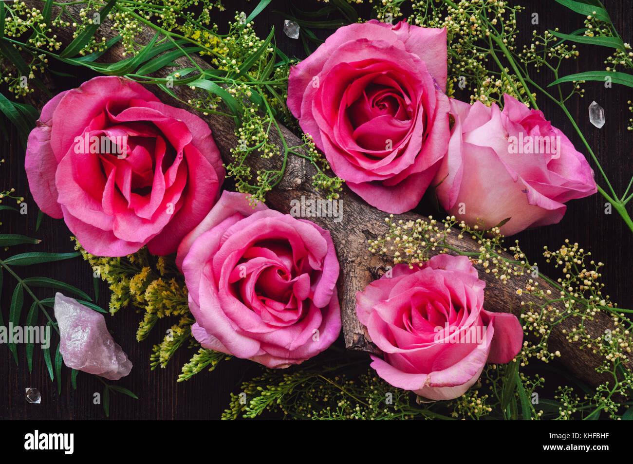 Pink Roses, Rose Quartz and Double Terminated Quartz Points Stock Photo