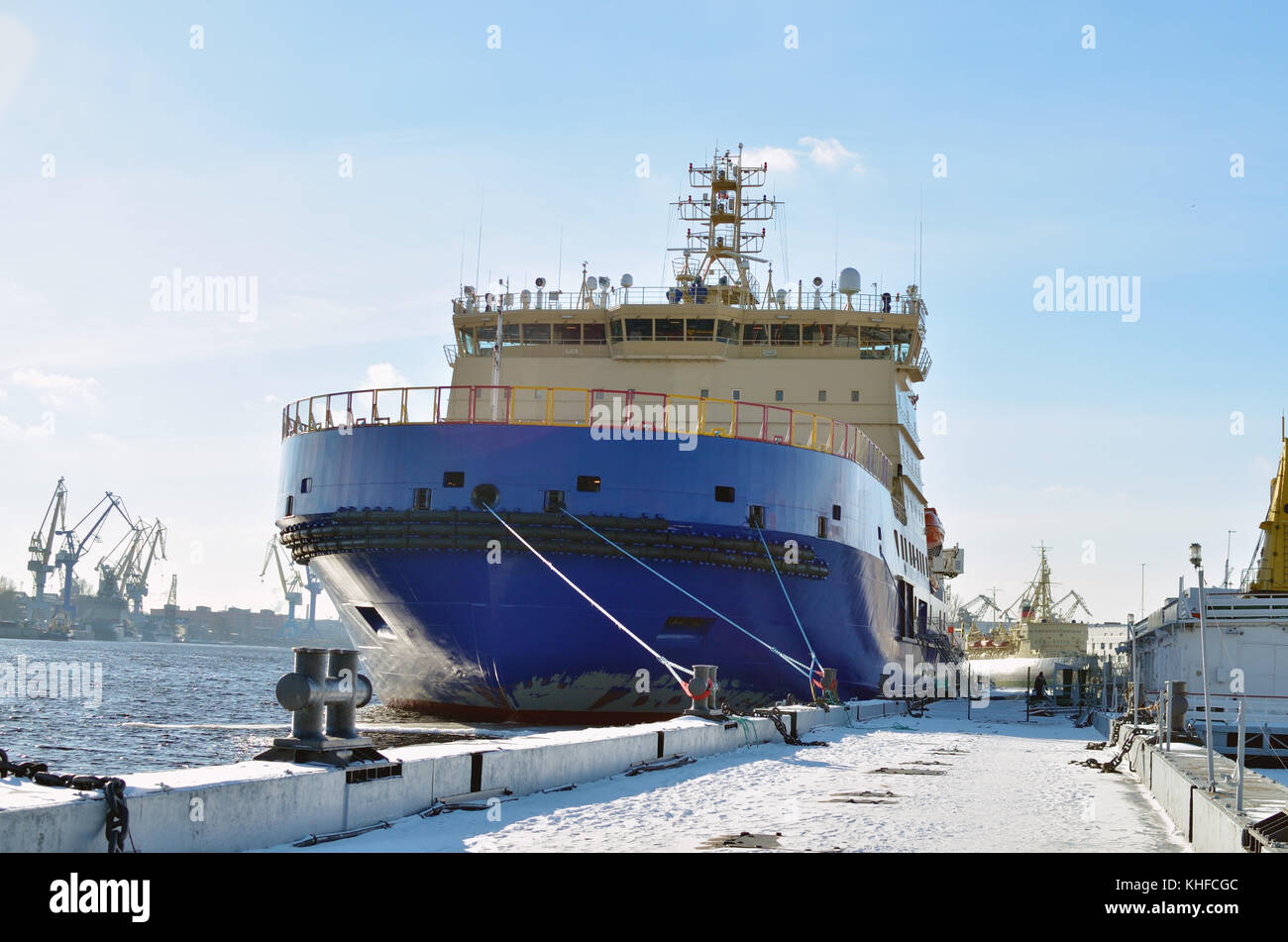 Large nuclear-powered icebreaker moored near the shore. - Stock Image