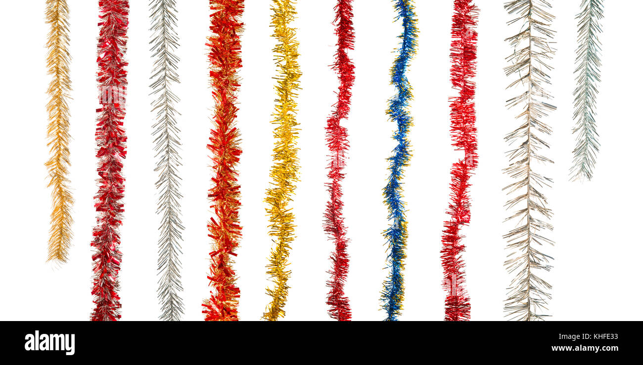 Large various christmas tinsel decorations collection. Isolated on white - Stock Image