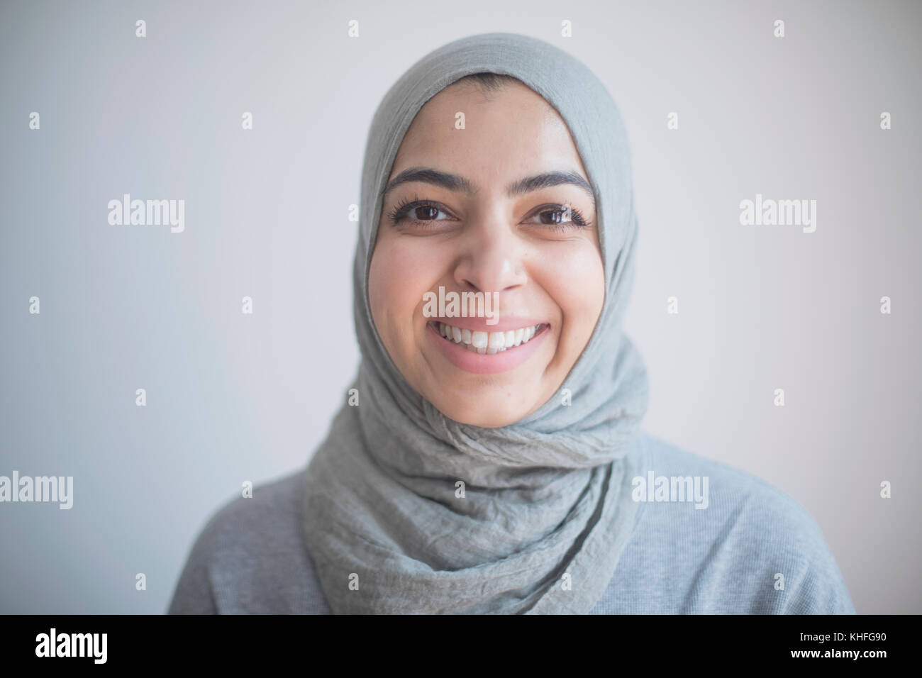 Portrait of a businesswoman wearing a hijab. - Stock Image