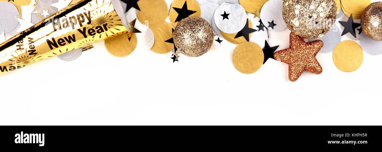 New Years Eve top border of confetti and decor isolated on a white background - Stock Image