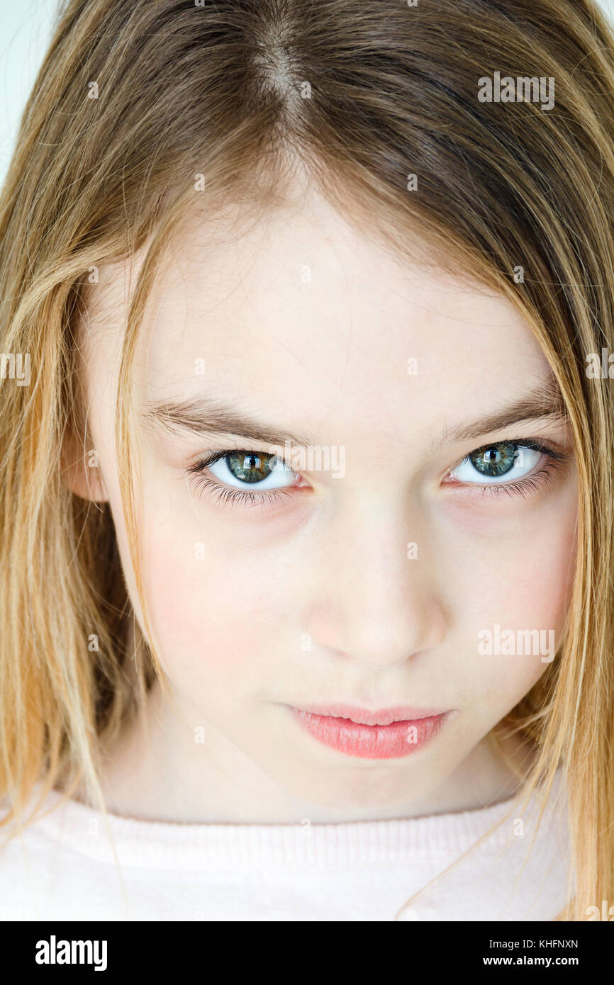 Cute Girl Eleven Years Old With Blond Long Hair And Green Eyes