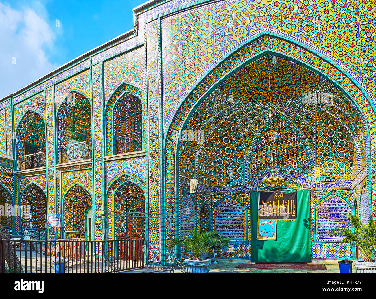 TEHRAN, IRAN - OCTOBER 11, 2017: The iwan (portal) of the Shrine of Syed Nasiruddin with complex Persian ornaments, - Stock Image